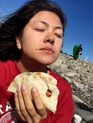 Having a spiritual moment with a soft taco supreme on the beach. (This is about as unflattering as it gets, folks.)